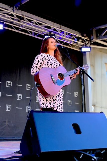 Demi Louise performs live at Federation Square (Melbourne, Australia) Photo credit: Dan Wilkinson Hot & Delicious: Rocks The Planet. www.hotndelicious.com